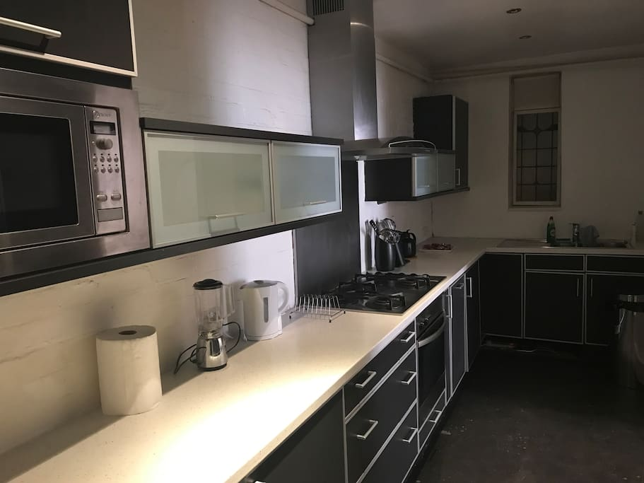 Fully featured kitchen including microwave, washer-dryer, fridge, freezer, kettle, juicer and dishwasher. Includes cutlery, crockery, pots and pans.