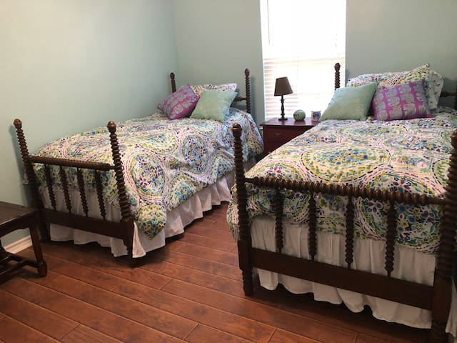 Twin beds and desk