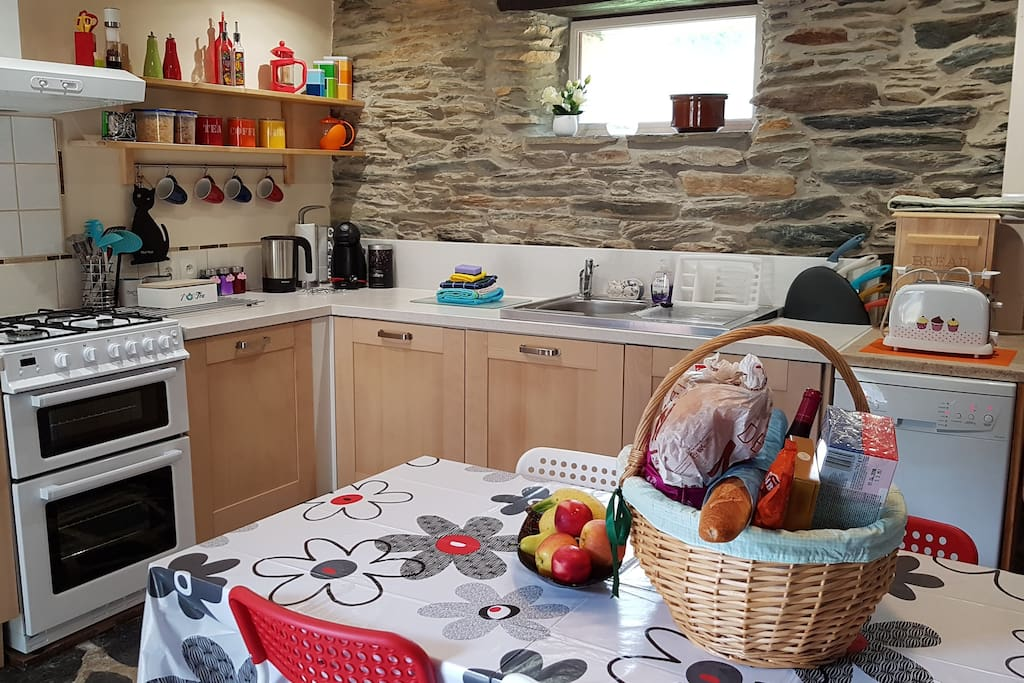 Kitchen - Open Plan, Fully fitted and equipped kitchen with cooker, fridge, dishwasher, microwave, toaster & Kettle. Table seats 4.  High Chair is also available. Everything you need is available,  crockery, tea & coffee,etc.