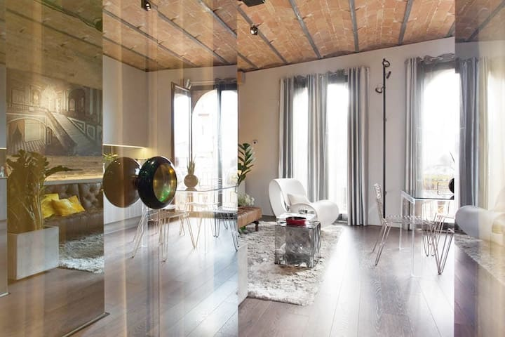 another view of the bright living room with its huge windows