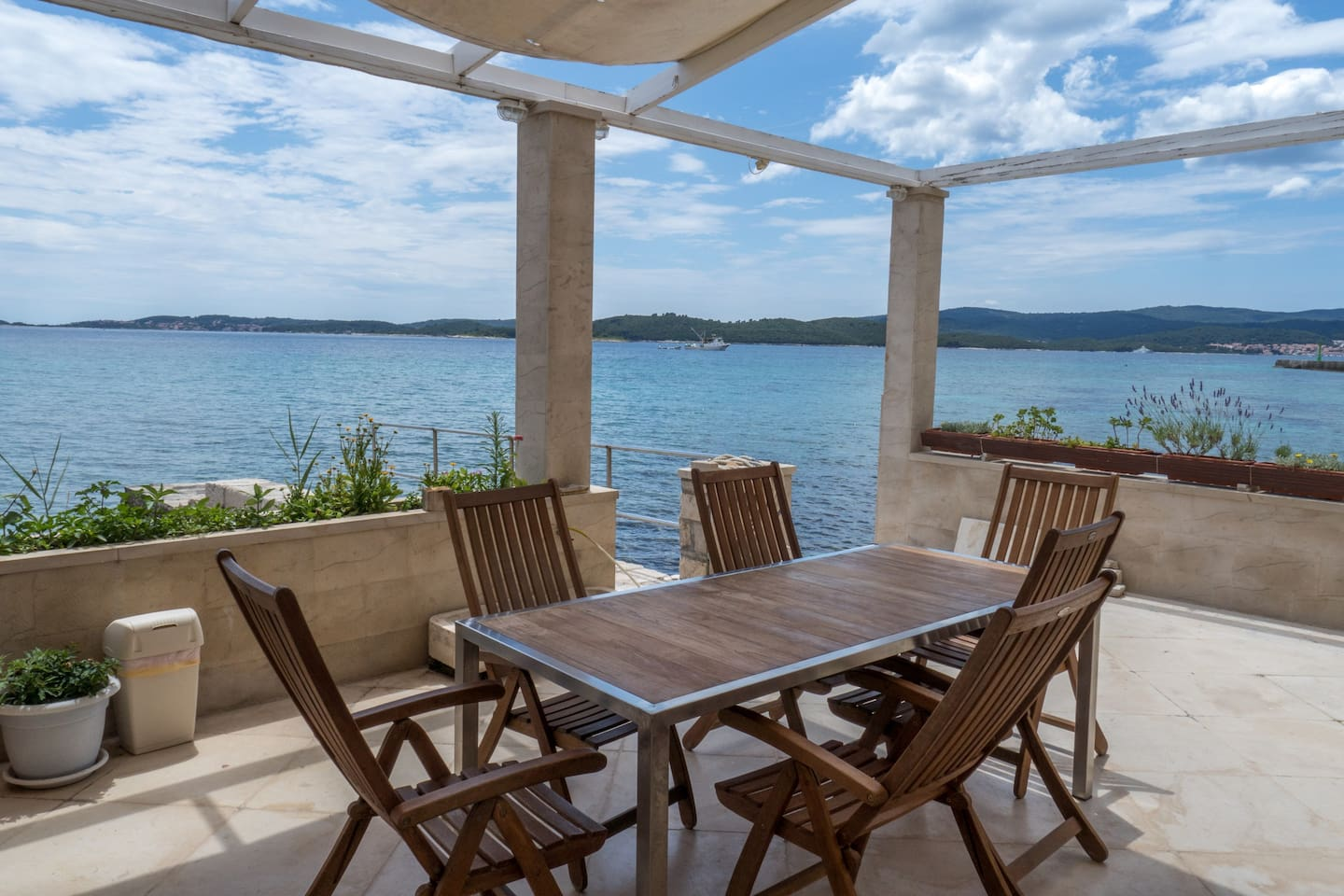 This covered terrace with sea view is perfect for your morning coffee
