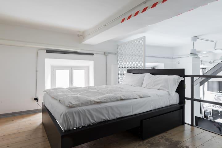 Mezzanine, second floor bedroom.