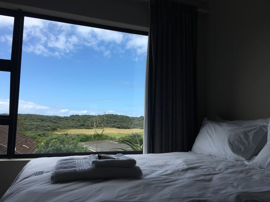 Bed with a view of the golf course
