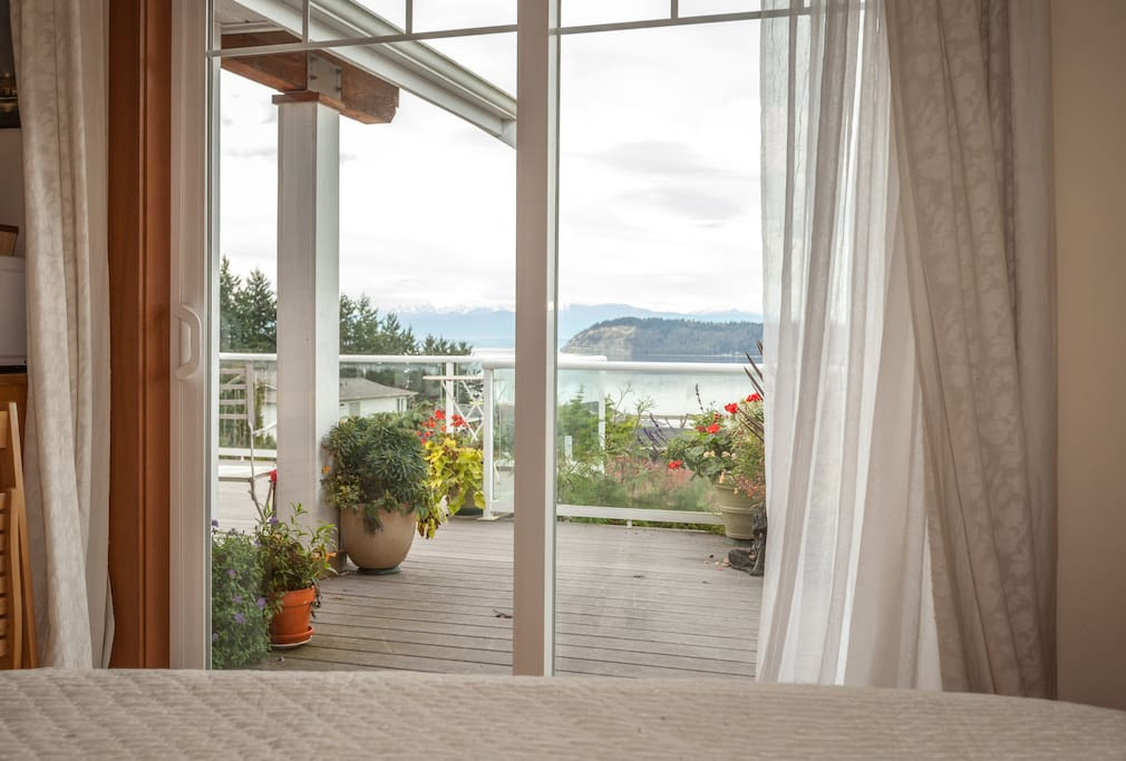 Your view from the Master's queen bed! See all the way to shore, Puget Sound to Useless Bay's Sunlight Beach and private access.