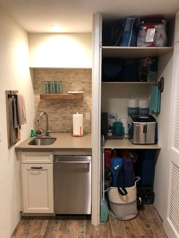Media room kitchenette with ice maker and beach going supplies