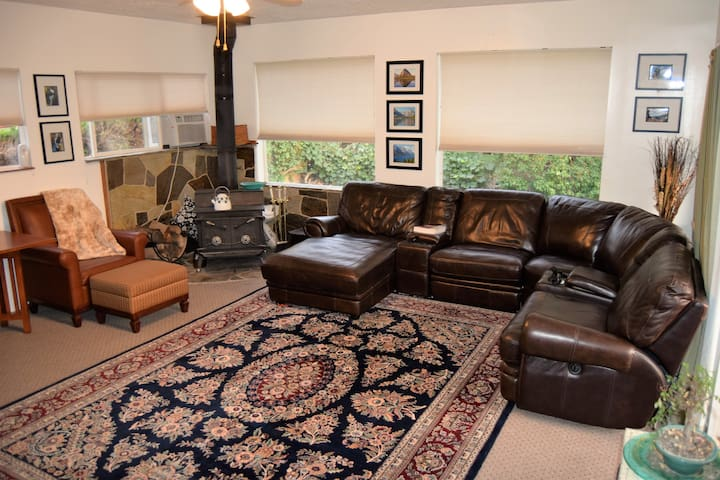 Sun room leather sectional and wood burning stove