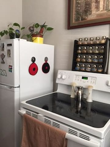 This fully equipped kitchen has a new refrigerator and new stove.