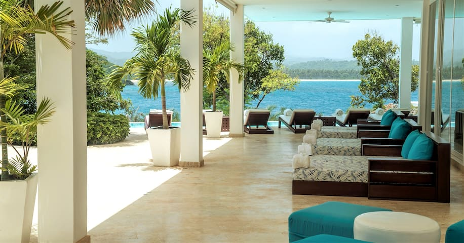 Enjoy the Stunning Ocean Views from the spacious terrace with sunbeds, lounge area and huge infinity pool.