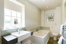 Ensuite to Bedroom 3 (bath and shower)