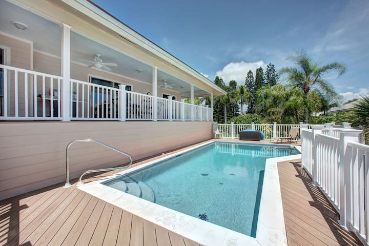 Heated swimming pool and deck with chaise lounges