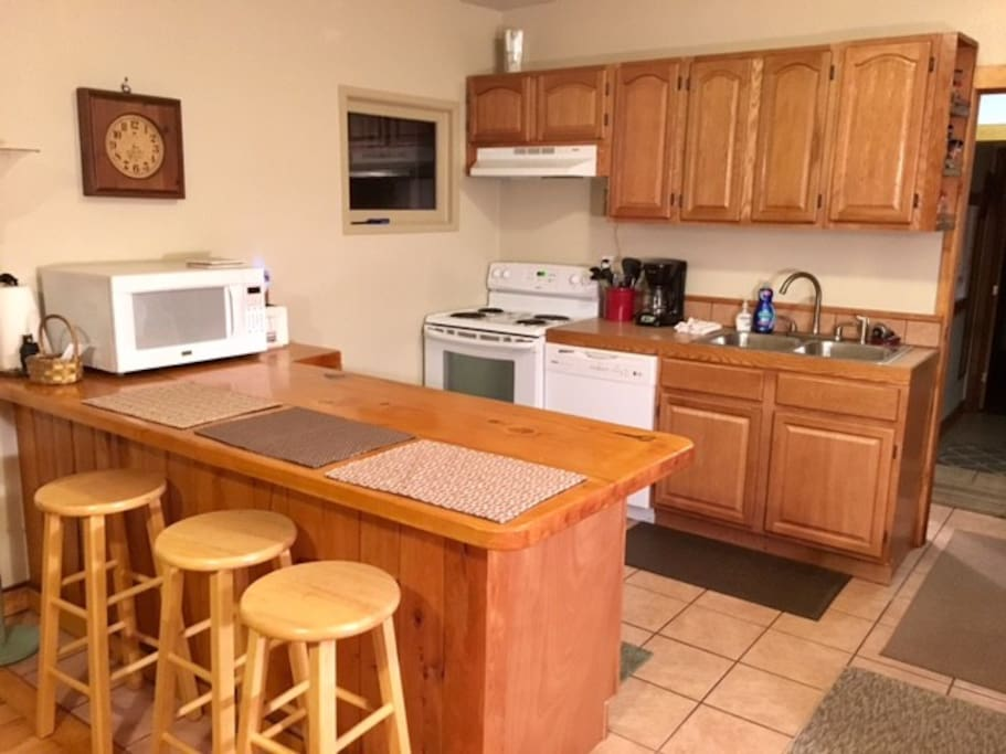 Spacious kitchen has dishwasher, microwave, fridge and stove