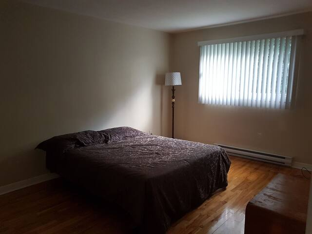 Room 1 in spacious Dorval apartment.