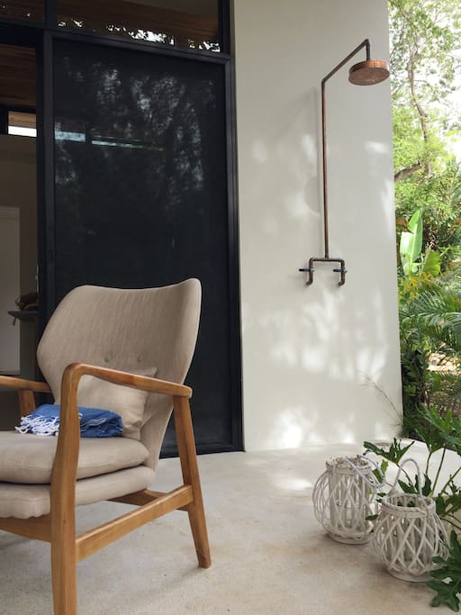 Enjoy an outdoor shower by the pool deck