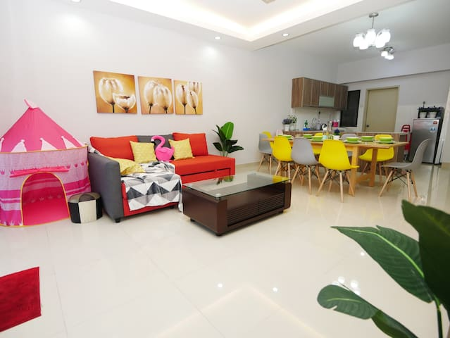 Spacious living hall with cozy sofa bed, play tent for your lovely children, extendable dining table to fit everyone.