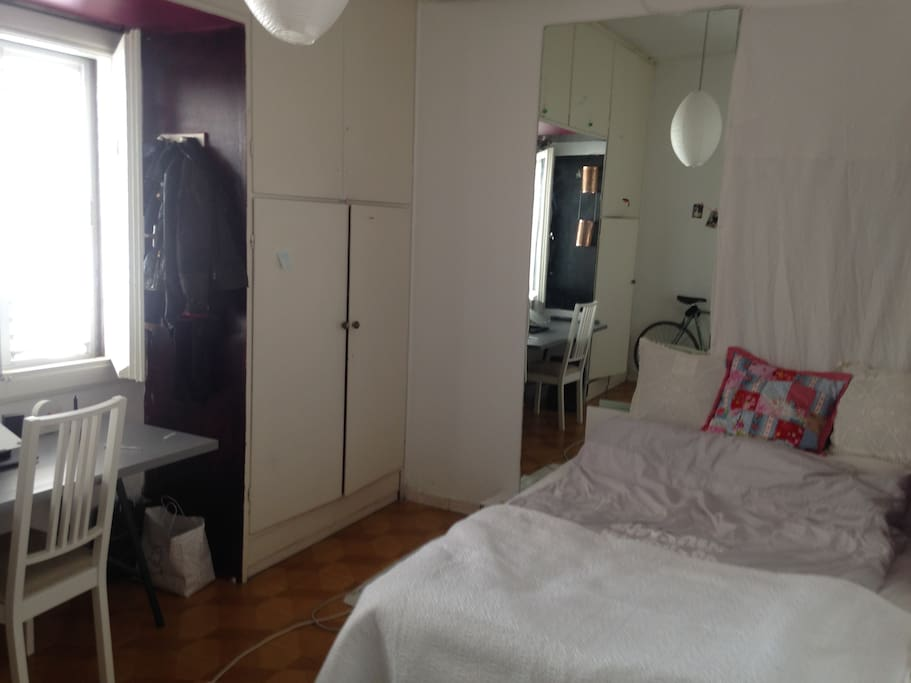 large private room with huge mirror, working desk, queen size bed, commode