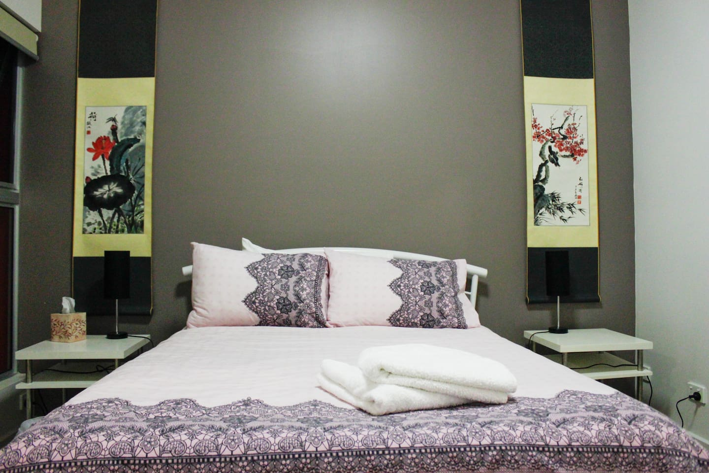 Main bedroom with Chinese paintings.
