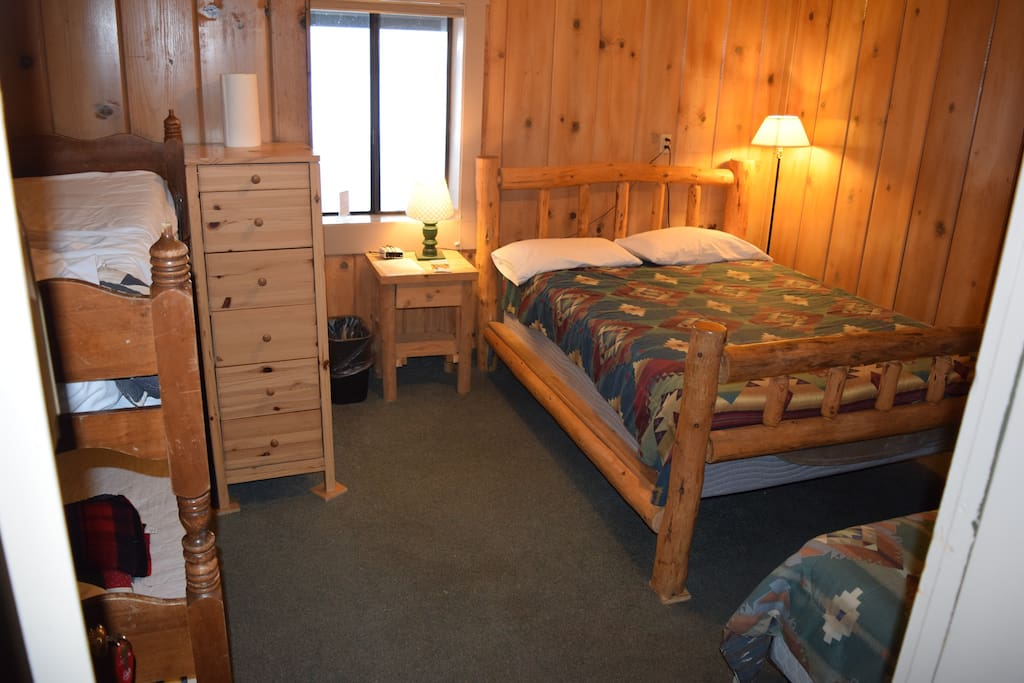 Lodge Room with Queen bed, twin bed and bunk beds (bring sleeping bags).,  Bathrooms down the hallway -separate for men and women.