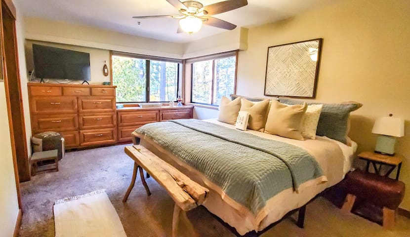 Master bedroom with ensuite bathroom, streaming tv, makeup mirror, large walk-in shower with two shower heads, large closet and plenty of built in storage for all of your belongings.  Automatic blinds as well.