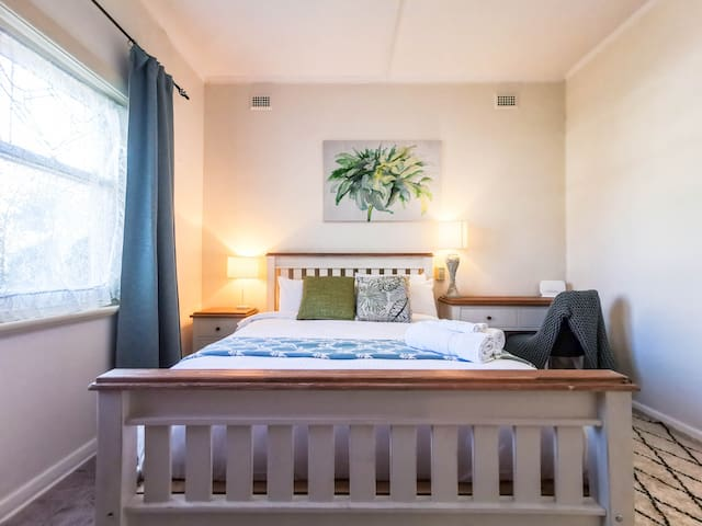 Bedroom #1 - Comfy wooden queen size bed with bedside table & lamp. Modern study table support your work and study. Separate wardrobe withstand enough clothes