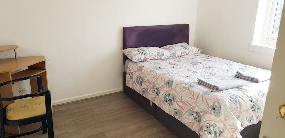 Bright double room with desk and storage