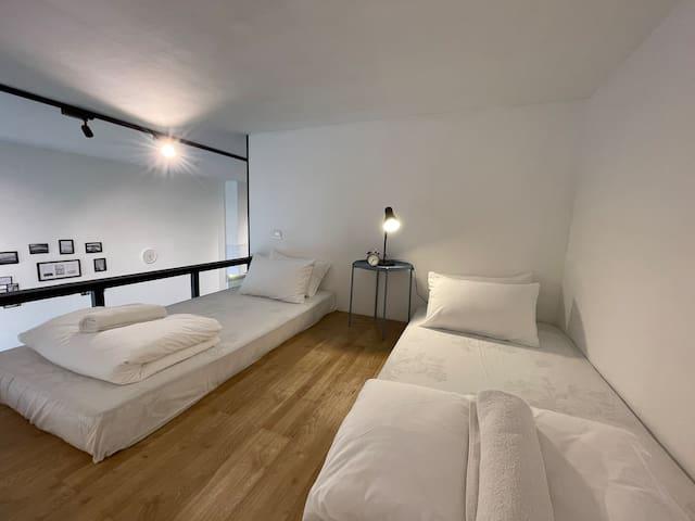 2 singles bed at the mezzanine floor