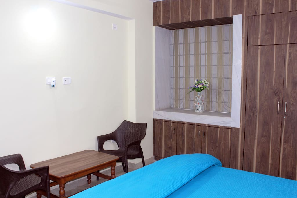 Room has King Size Bed with Comfortable Mattress, Bedsheet, Comforter & Pillows alongwith Dressing cum Work Table, Chairs, Centre Table & Side Tables, Wardrobes and others.