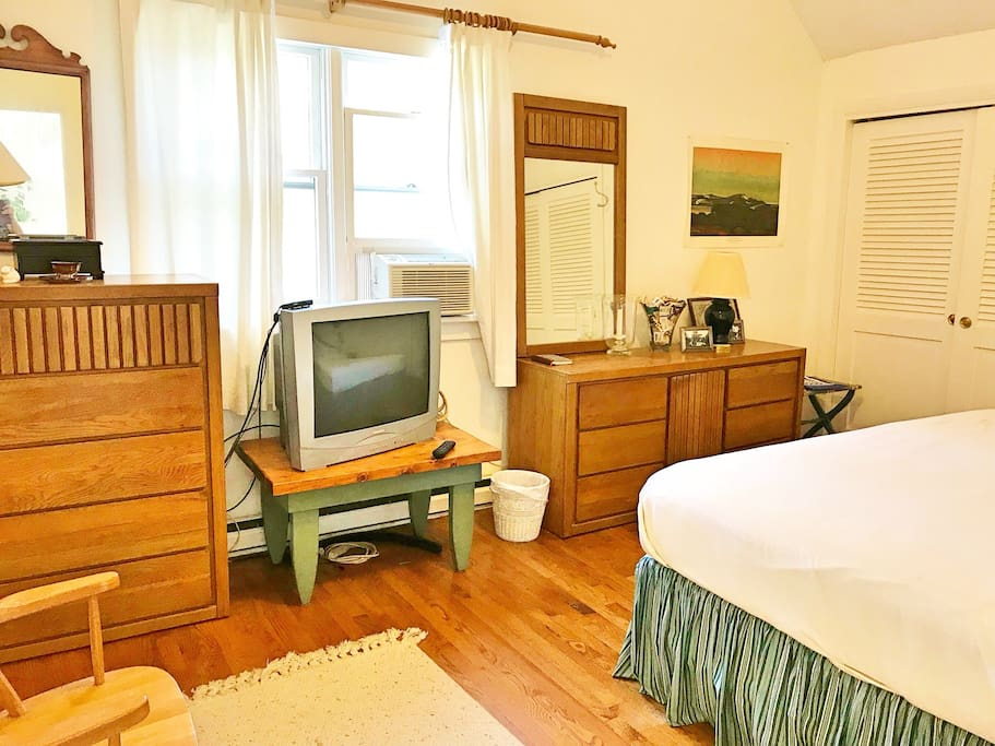 Room #1 (Private bedroom with door) Features: King size bed, closet, dressers, hardwood floors, cable TV, Air conditioning and heating.