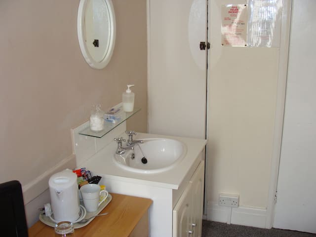Wash basin and there is a separate but private shower room