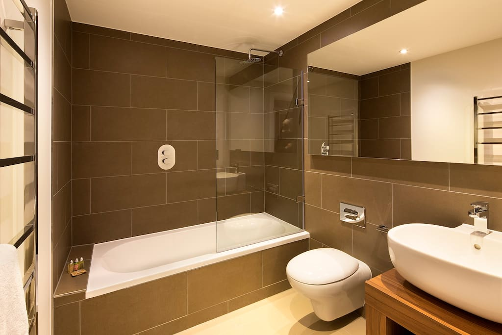 Spotless bathroom with designer toiletries