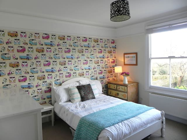 Funky wallpaper in the smallest room which is still a large double room and has views over the garden