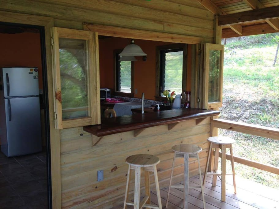 Kitchen Pass Through with bar seating on the deck