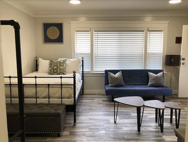 Full bed, futon sitting area, lots of space