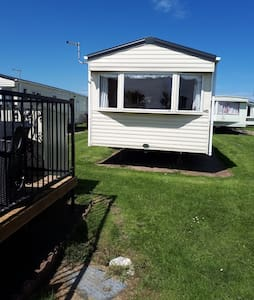 Sand Le Mere Caravan. Dog friendly and very cosy!