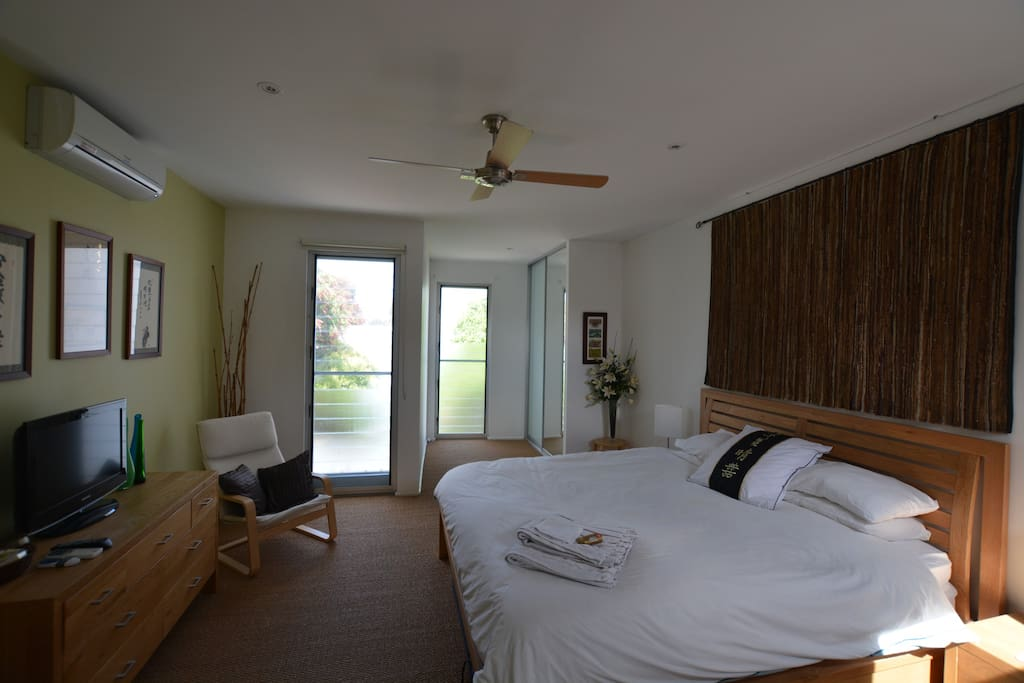 Large main bedroom with comfy King Bed
