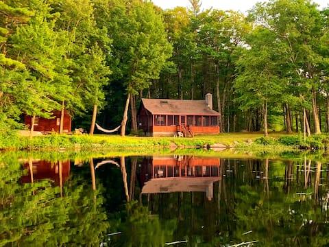 Beautiful log cabin on water