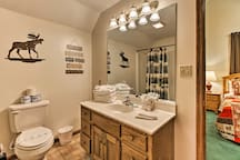 Freshen up at the mirrored vanity!