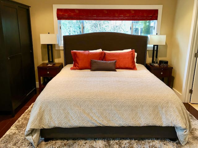 Master Suite #1 - King Tempurpedic bed on main floor with an en-suite bath & direct access to deck.