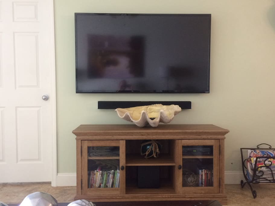 Family room features a 60 inch TV, Sound bar with sub-woofer, DVD player and a DVD library for your enjoyment.