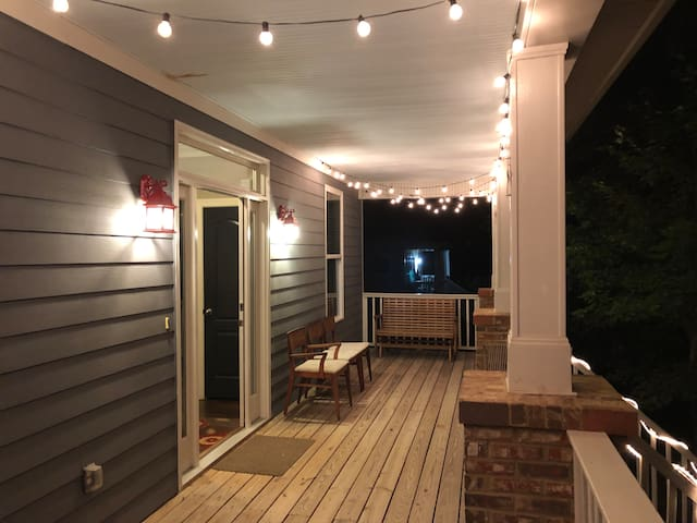 Front porch is furnished and well lit. Lights come on at dusk and stay on for a few hours.