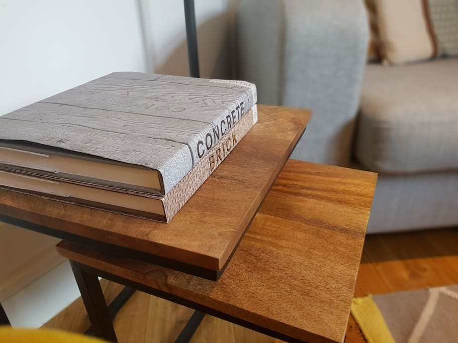 Side tables and books in the lounge area