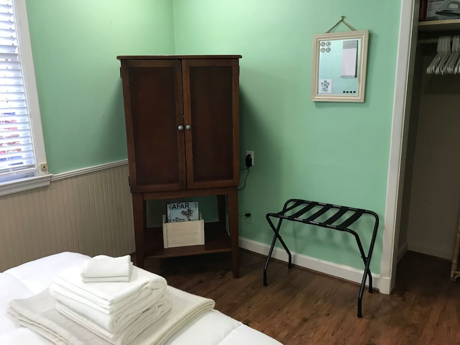 Armoire with TV, Roku and bluetooth speaker.  Closet and luggage rack. White noise machine.