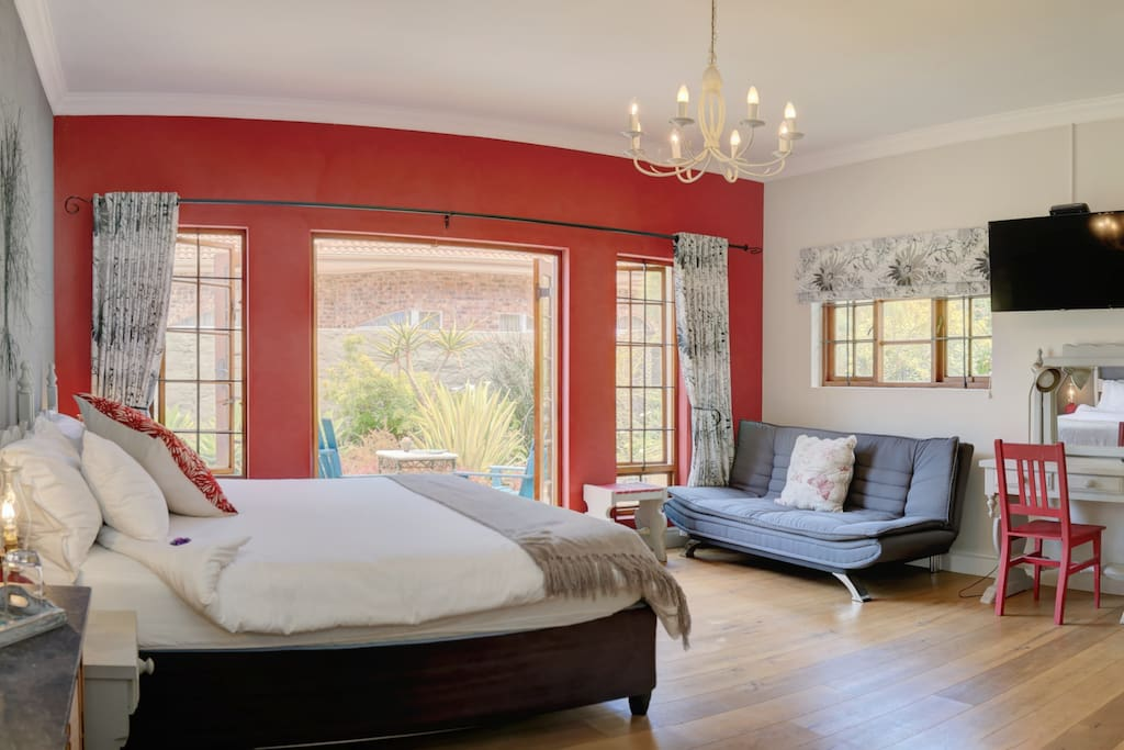 Tree of Life - sleeps 3 guests in a king size bed with extra length and a sleeper couch.