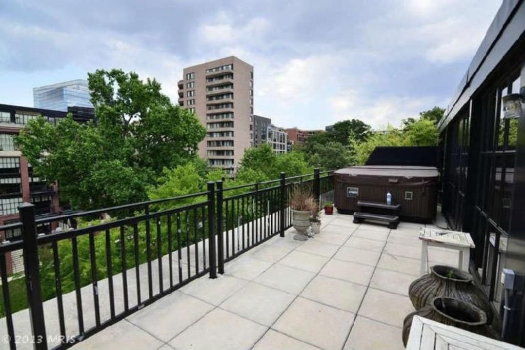 Penthouse with 2 levels & private rooftop with multiple sides and hot tub with view of US Capitol! Please note that the propane grill & hot tub on the terrace/from pictures ARE NOT AVAILABLE FOR GUEST USE BECAUSE OF UPDATED CONDO ASSOCIATION RULES