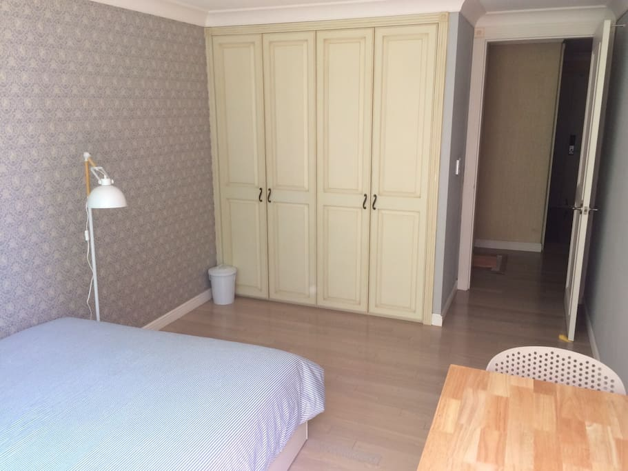 Room with a wardrobe and enough space.
