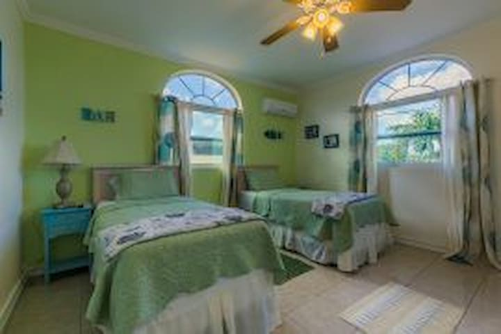 Large open airy 2nd guest room with 2 twins beds, can accommodate 2 more foldaways (twin) or graco pack and play cribs)