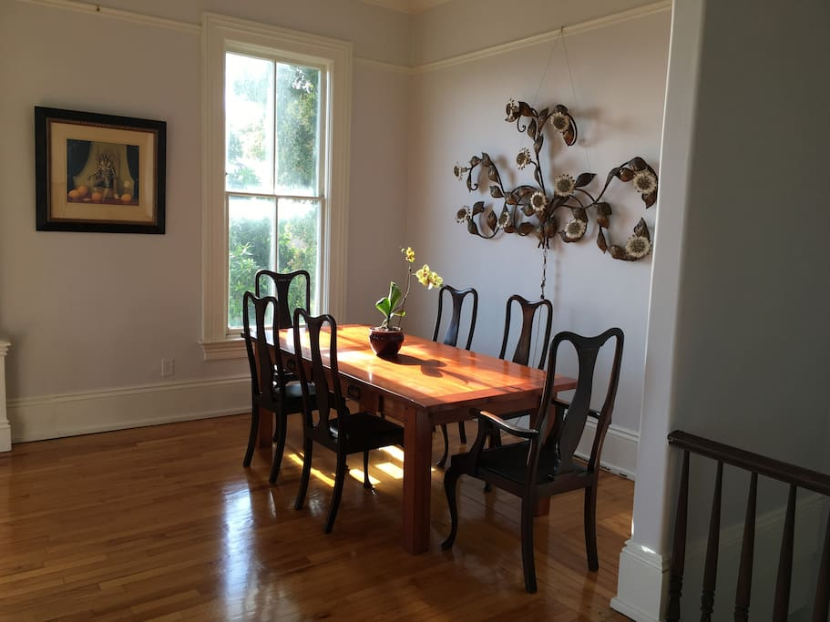 Living room with antique Italian wall sconce and dinning table for 8.