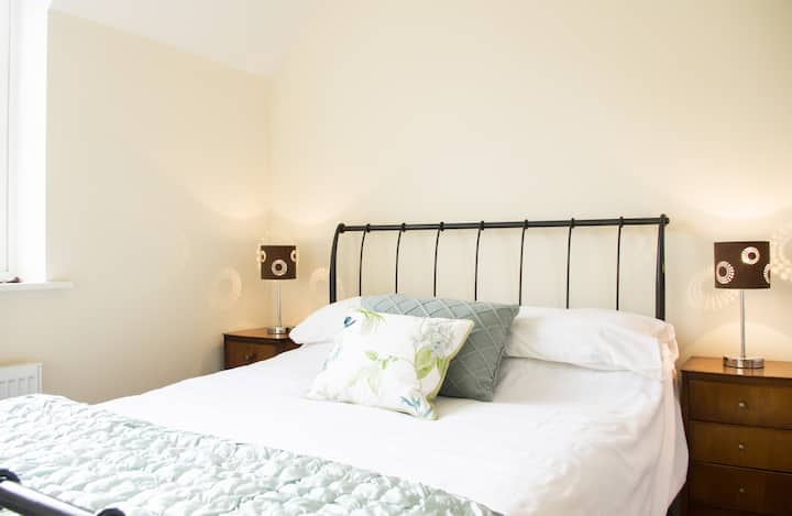 Two bedroom, two bathrooms, modern Coach House.