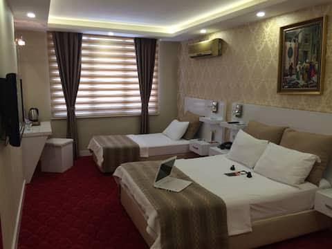 Otel Çavuşoğlu - Deluxe Üç Kişilik Oda