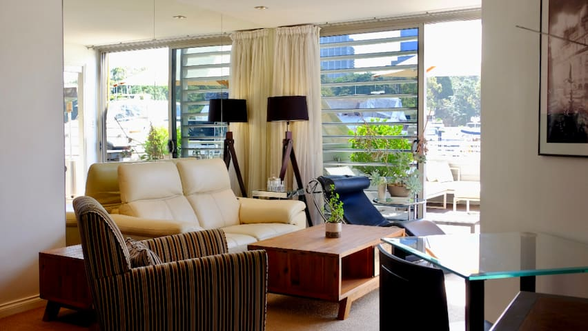 Living area. TV with everything. Views of the marina and harbour. Perfect for relaxing after enjoying Sydney for the day.