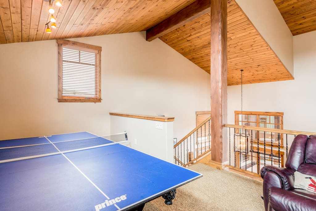 Challenge friends to a game of ping-pong or pool in the loft.